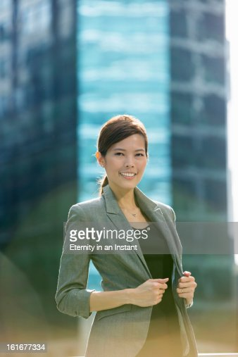 Asian businesswoman smiling  in city : Stock Photo