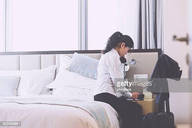 asian businesswoman talking at hotel