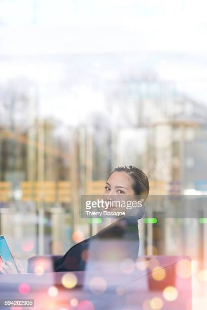Asian businesswoman using a digital tablet in offi