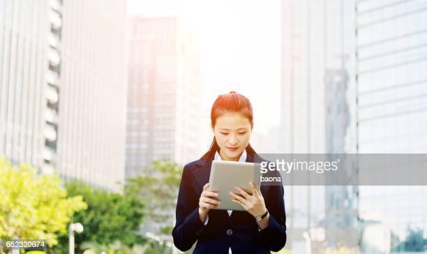 Asian businesswoman using digital tablet
