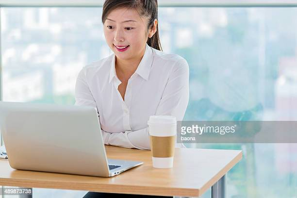 asian businesswoman working on laptop