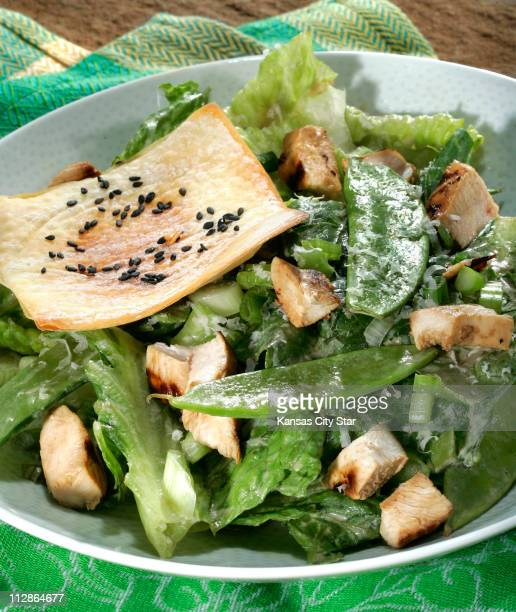 Asian Caesar salad with grilled chicken and crisp wontons