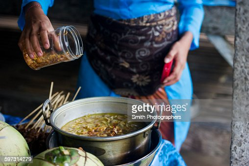 Asian chef cooking in outdoor kitchen