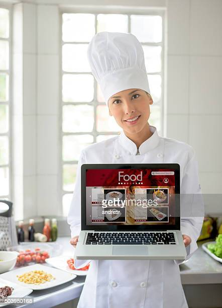 Asian chef holding an online menu