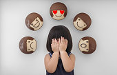 3d rendering of emotion icons on wall and portrait of a little girl combined