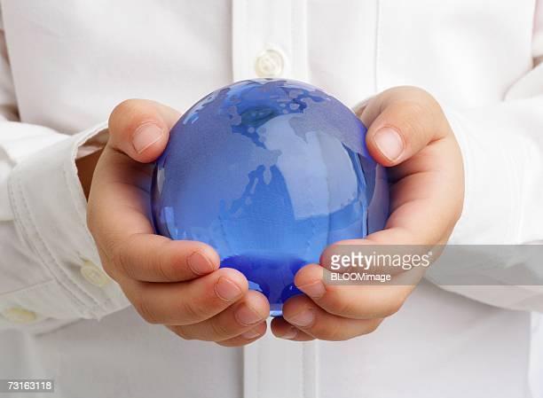 Asian child holding glass ball