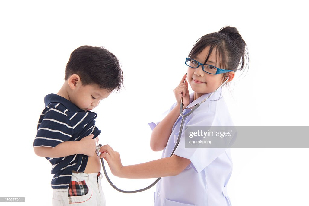 Asian children playing as doctor and patient : Stock Photo