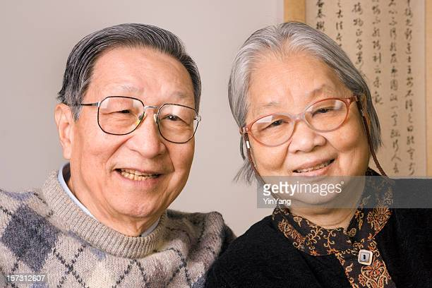 Asian Chinese Senior Couple, Happy, Smiling Retired Grandparents Lovingly Together