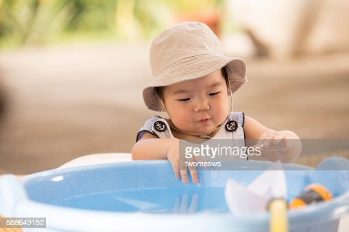 Asian Chinese toddler water play.