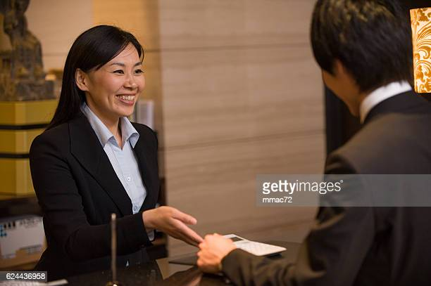 Asian Concierge in Hotel with Customer
