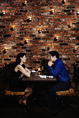 Asian couple eating at restaurant