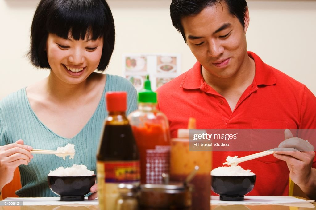 Asian couple eating rice : Stock Photo