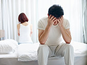 young asian couple with relationship problem appear depressed and frustrated.