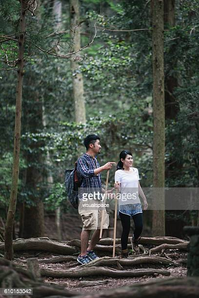 Asian Couple Hiking in the Woods