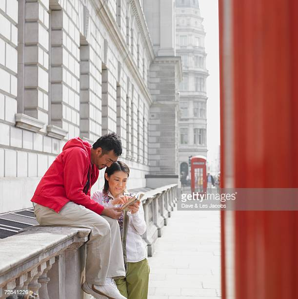 Asian couple looking at map in London