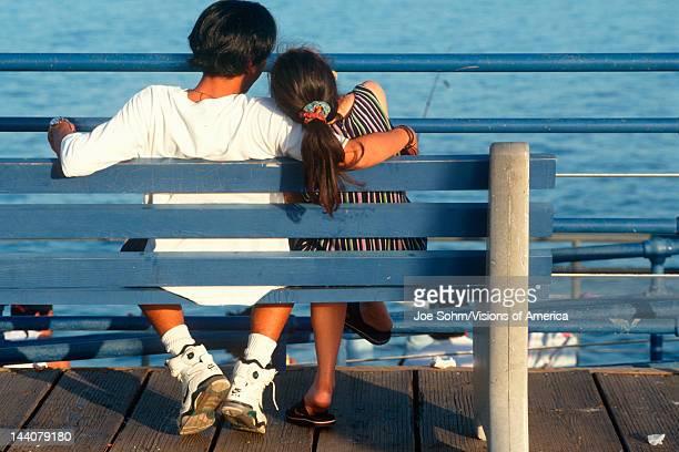 Asian couple on bench at Santa Monica Pier California