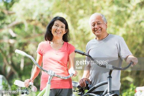 Asian couple riding bicycles