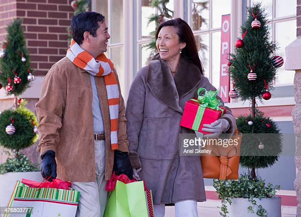 Asian couple shopping together at Christmas time