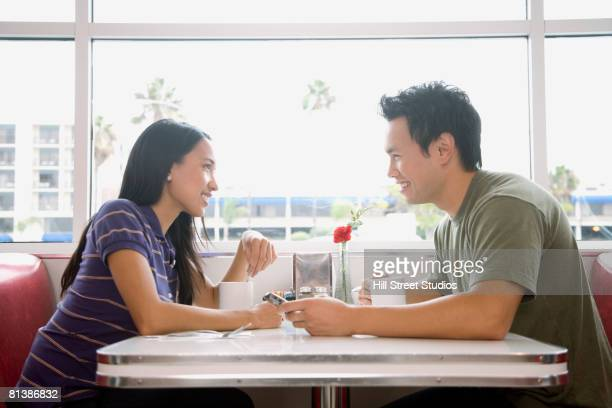 Asian couple smiling at each other