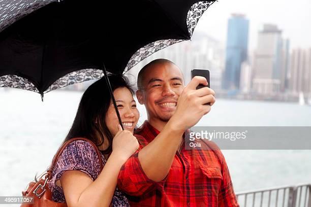 Asian couple taking selfie