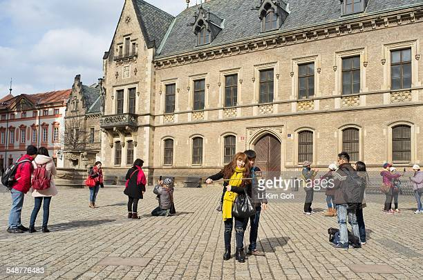 Asian couple taking selfie with selfie stick at Prague Castle ground Czech Republic