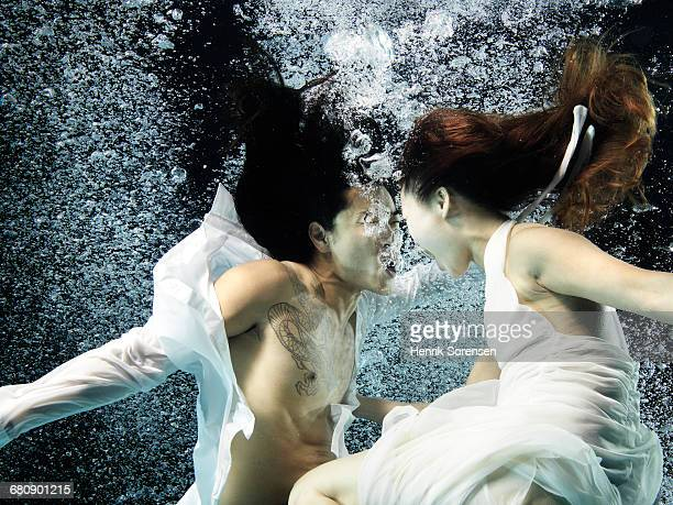 Asian couple under water