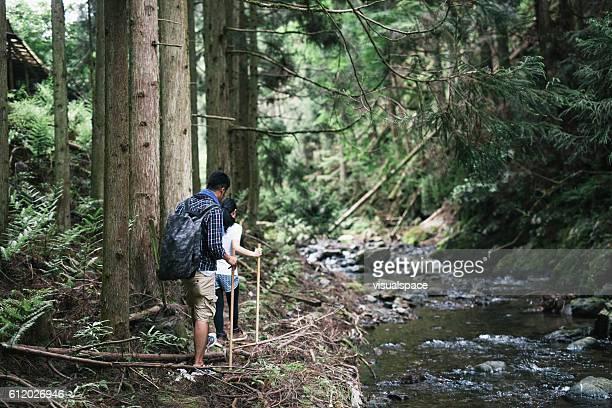 Asian Couple Walking on a Riverside