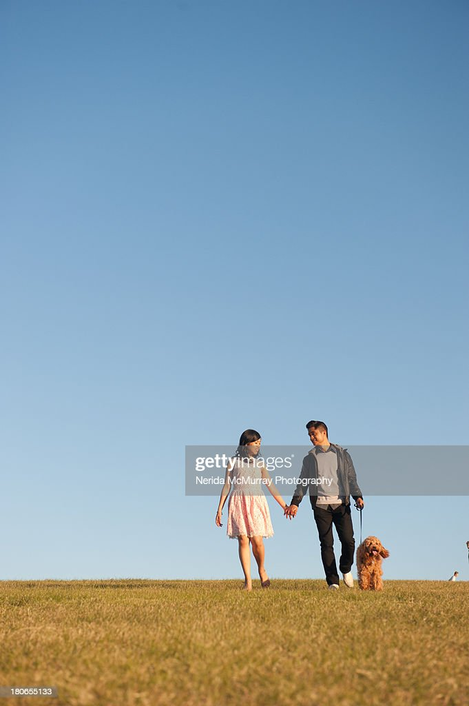 Asian couple with dog : Stock Photo