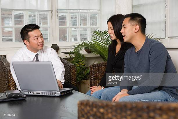 asian couple with financial advisor