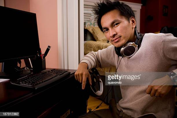 Asian Desktop Gamer Using PC, Smiling at Camera, Copy Space