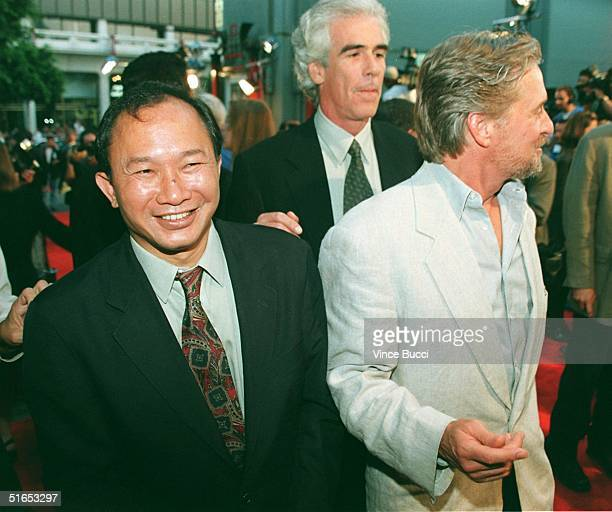 Asian director John Woo and produceractor Michael Douglas arrive for the world premiere of their new film Face Off 19 June in Hollywood CA Woo...