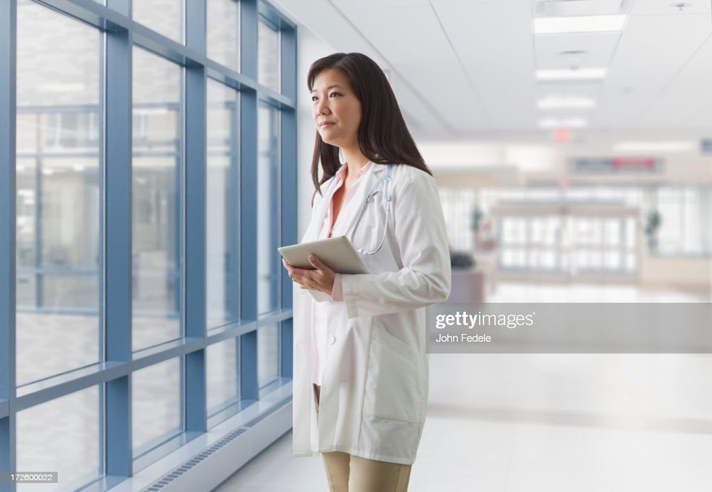Asian doctor walking in hospital : Stock Photo