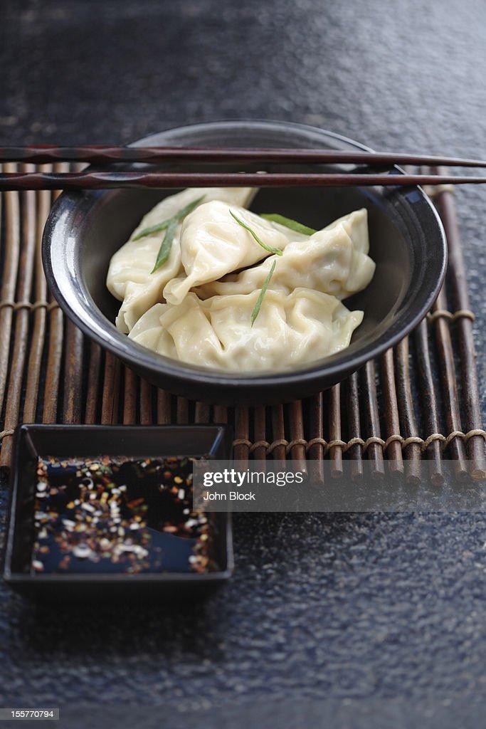 Asian dumplings in bowl : Stock Photo