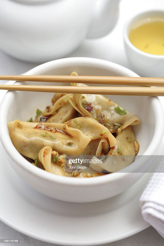 Asian dumplings in bowl : Stock Photo