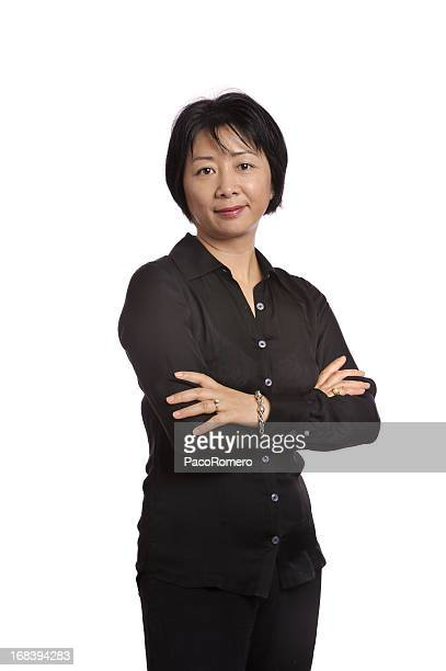 Asian executive displaying confidence with arms crossed