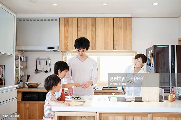 asian family cooking in the kitchen together