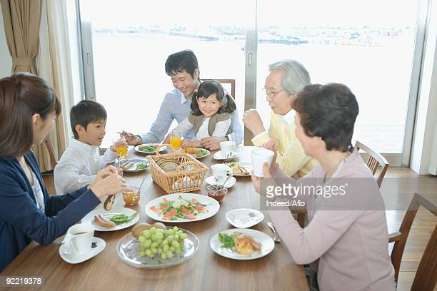 Asian family having breakfast together