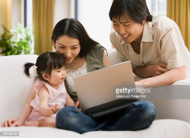 Asian family looking at laptop