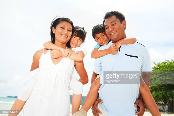 Asian family on the beach