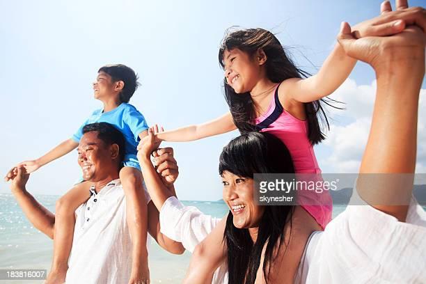 Asian family on the beach.