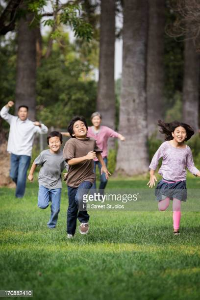 Asian family playing together outdoors