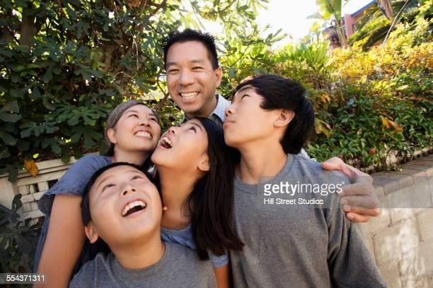 Asian family smiling in garden