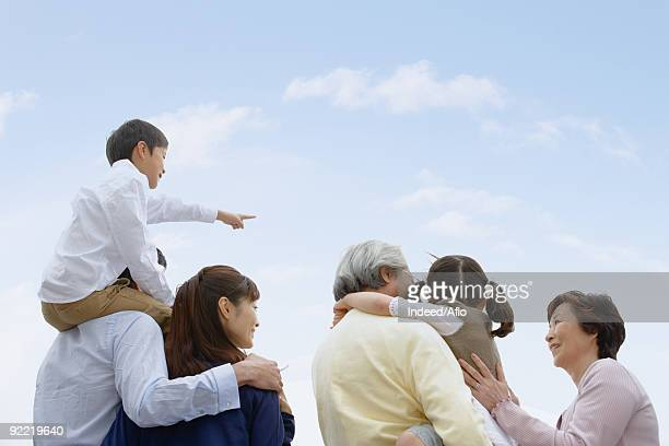 Asian family standing together