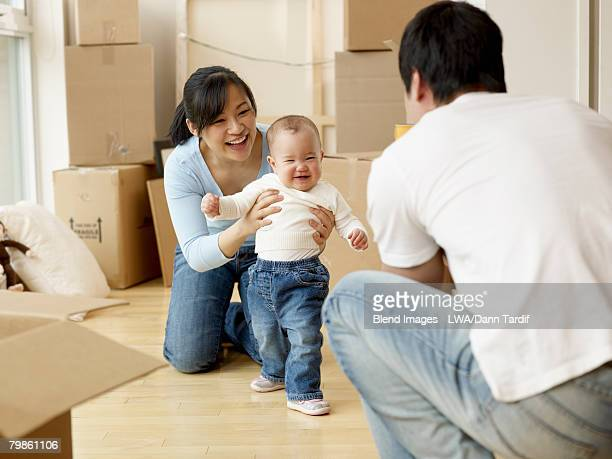 Asian family with baby in new house
