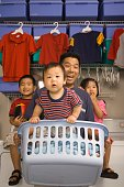 Asian father and children in laundry room