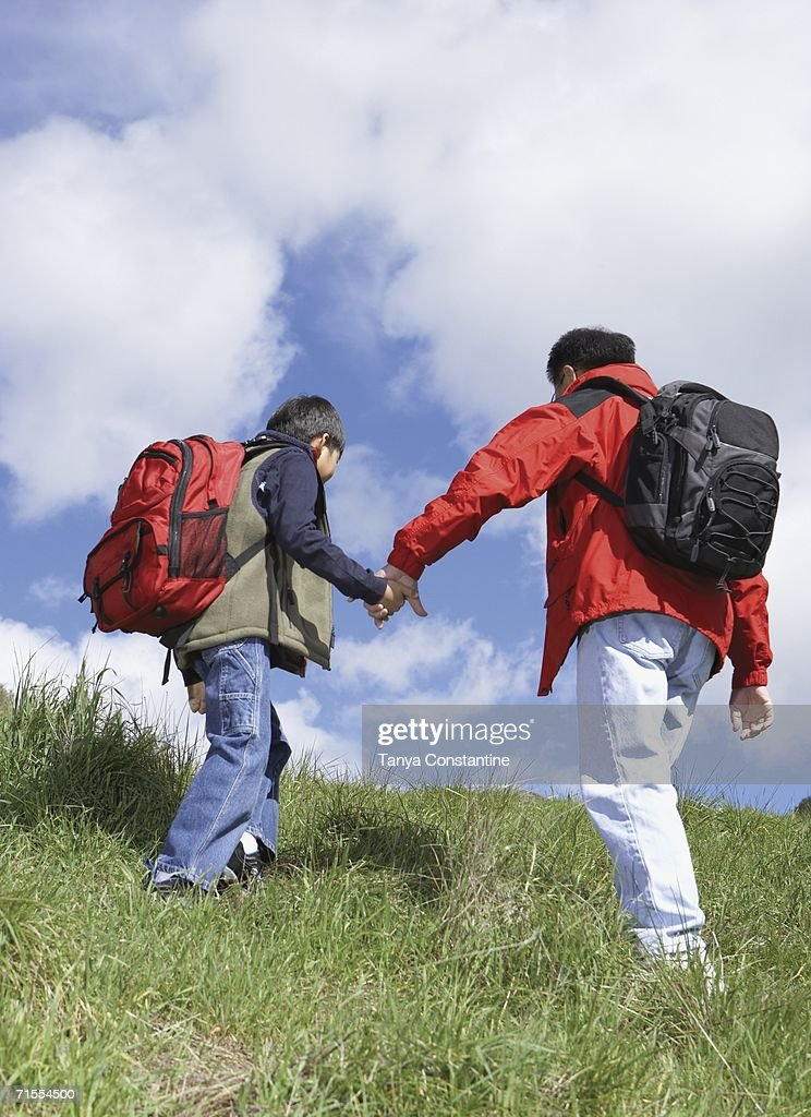 Asian father and son backpacking : Stock Photo