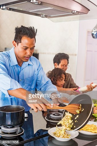 Asian Father Cooking Healthy Food in the Kitchen : Stock Photo