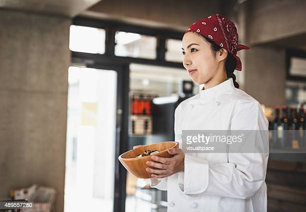 Asian Female Chef Carrying a Meal