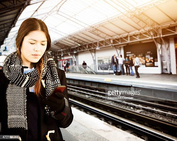Asian female commuter checking her messages