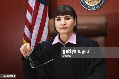 Asian Female Judge Seated in Courtroom
